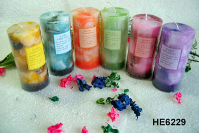 Scented pillar candles with colored wax pieces inside