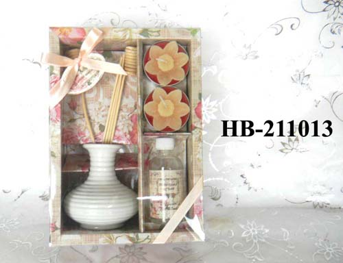 reed diffuser with scented candles in gift box